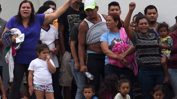 Image result for A large group of mainly Cuban migrants escaped on foot from the immigration detention centre in Tapachula on Mexico's southern border