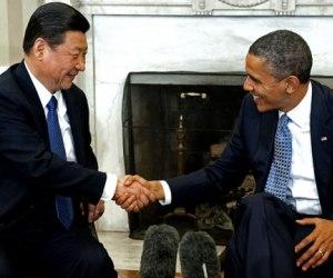 El presidente de Estados Unidos, Barack Obama, y su homólogo chino, Xi Jinping, acordaron el viernes trabajar juntos para resolver las disputas sobre la seguridad cibernética