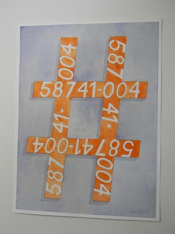 NUMBER  (Número)  Es un símbolo de Número en color naranja y su número de identidad. No solo te quitan la libertad sino que te convierten en un número, el cual tienes obligatoria y necesariamente que aprenderlo en inglés, porque te lo preguntan cada vez que te trasladan a cualquier lugar, ya sea la Sala de la Corte o a donde vayas.  Jamás  preguntan por tu nombre.