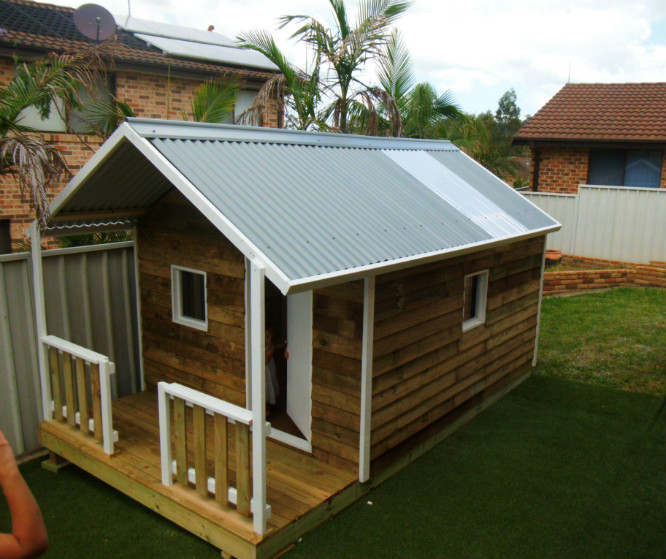 cubby house 3.4m x 2.4m with deck, x2 perspex windows, ply door, slight elevation, painted trim $2660