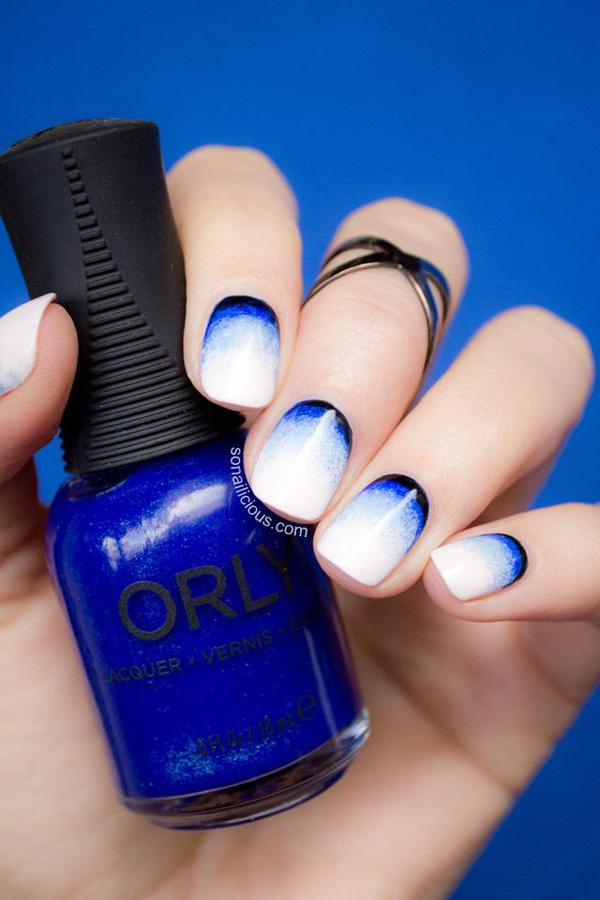A Pretty Looking Nail Art Design In Bold Shapes Using Baby Blue And White Polish With