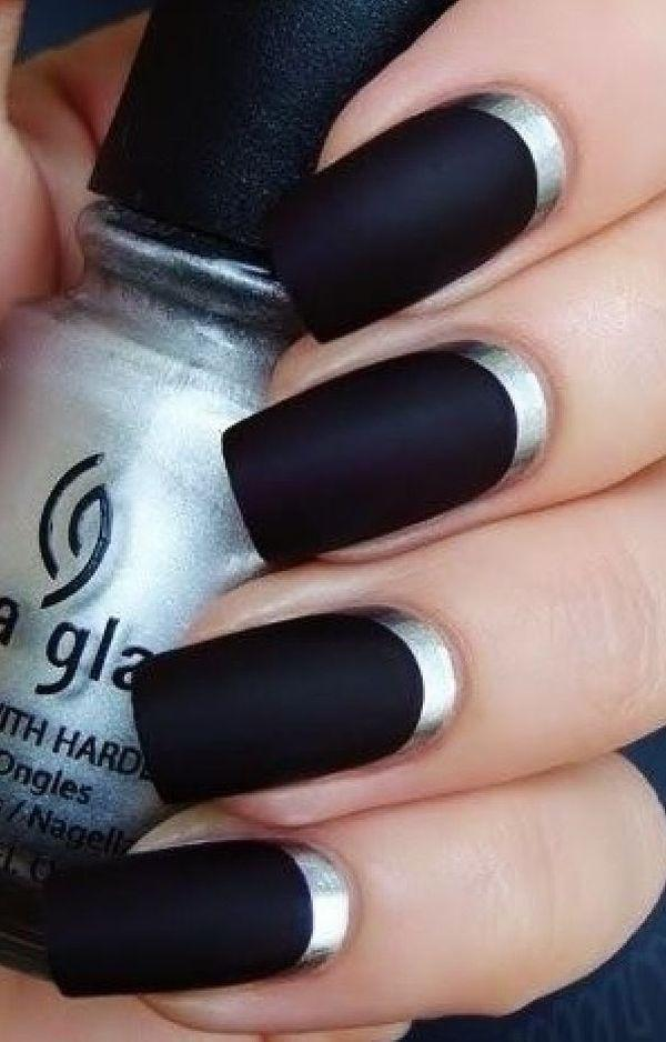 An Artistic Matte Black And Silver Nail Ensemble Making Use Of Metallic Polish To Cover