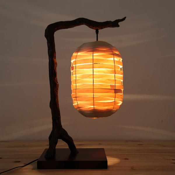 Wooden Chinese lamp. A lamp with a traditional twist to it. Simple yet it looks very symbolic and creates a great ambiance in the room.