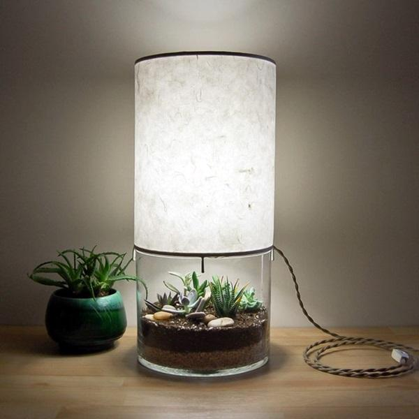 Mini greenhouse lamp. Why not have a mini garden under your lamp and use the light from the lamp to illuminate the greenery; simple yet very pretty.