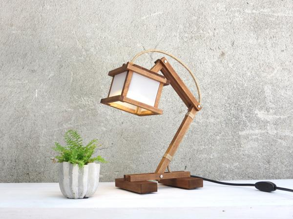 Cute wooden lamp. Fastened at the joints, this lamp looks as though it was conventionally made by carpenters and looks absolutely creative.