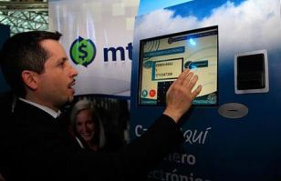 An account holder takes a tutorial of the Central Bank's new electronic money system that will operate by cell phone.