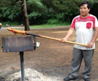 Ecuadorian grilling a guinea pig in Prospect Park. It was okay since it wasn't a squirrel.