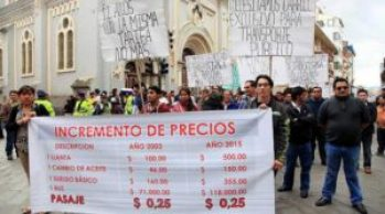 Bus owners and drivers march up Simon Bolivar on Monday demanding a fare increase.