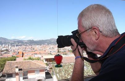 Bill Riordan takes pictures from his balcony, overlooking the historic district.