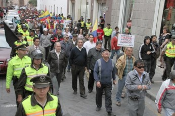 Some anti-government protesters in Cuenca carried signs opposing the city's new tram system.