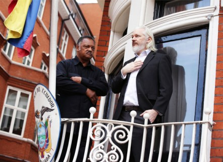 Julian Assange extradition. WikiLeaks founder Julian Assange (right) with Reverend Jesse Jackson outside the Embassy of Ecuador in London. Picture date: Friday August 21, 2015. See PA story LEGAL Assange. Photo credit should read: Yui Mok/PA Wire URN:23873385