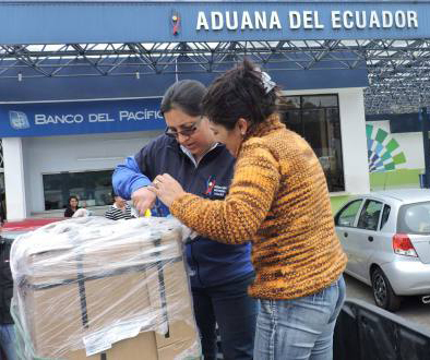 A customs agent inspects a package in Guayaquil. Photo credit: El Universo