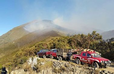In the Cajas Mountains, fire fighters are forced to hike into remote areas to fight fires.