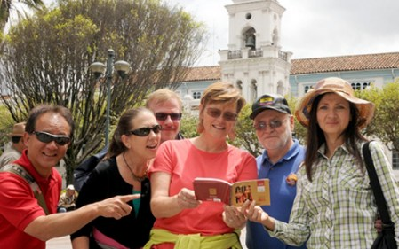 A group of Cuenca expats mug for the camera, checking out the new holiday agenda.