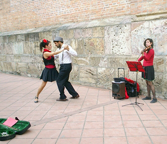 Argentine street artists do the tango by the cathedral.