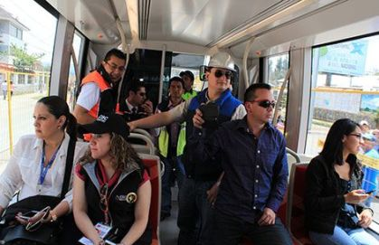 Passengers ride the tram for the first time.