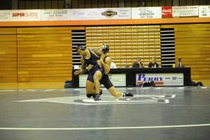 Geoffrey Merker (right) wrestling.