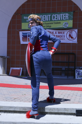 Dressed as Captain America, student Gage Washburn showed the crowd how to properly walk in high heels.
