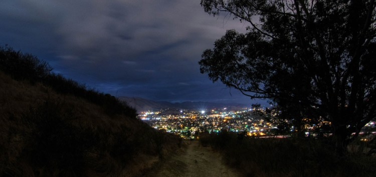 Beyond the Cerro San Luis Trail lies the city of SLO at night.