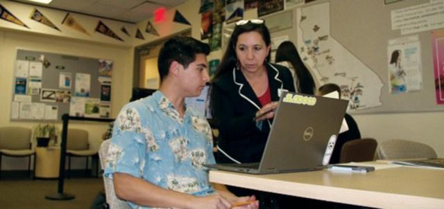 Estella Vazquez, enrollment success specialist, assists Cuesta student in the transfer center.