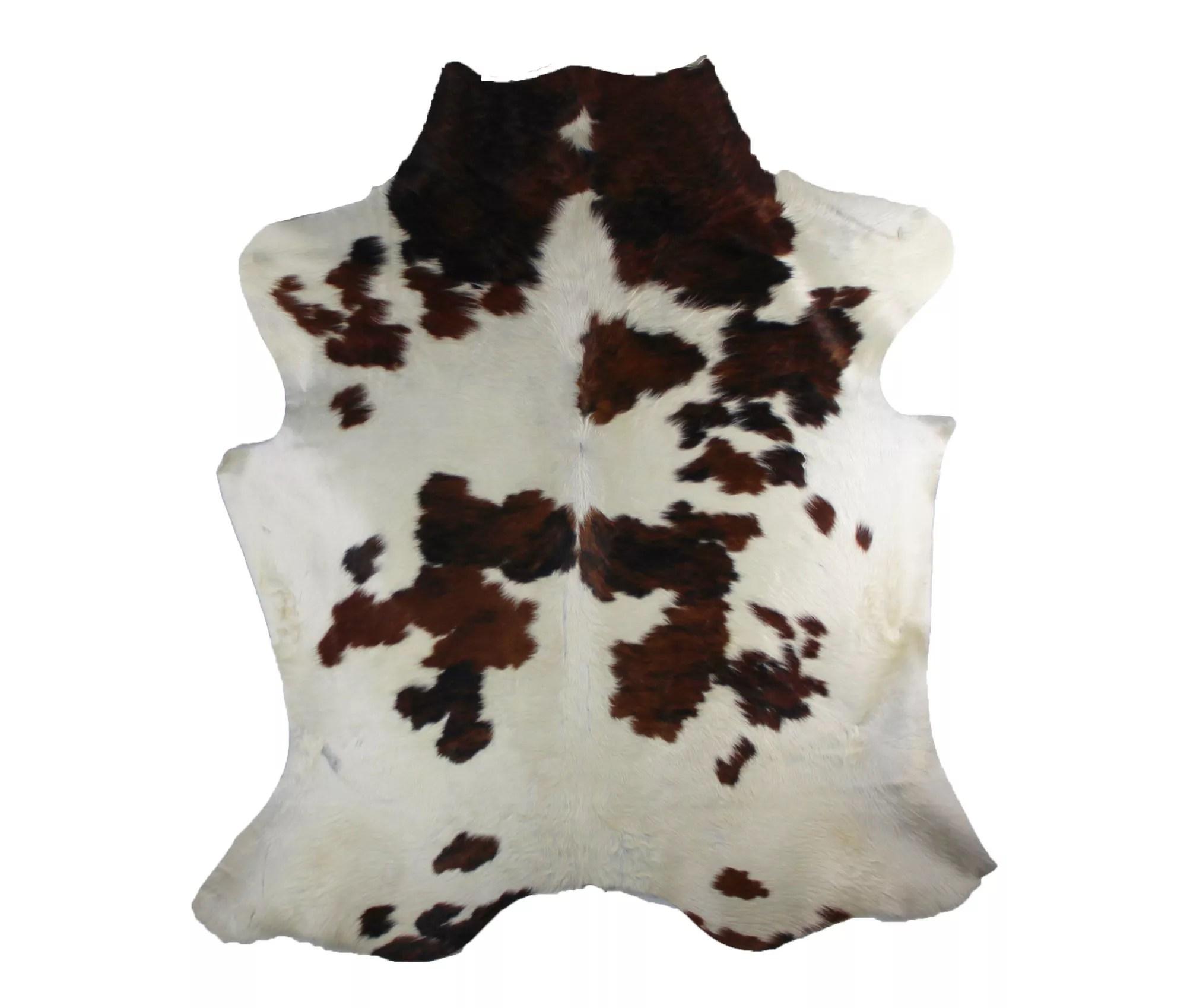 tapis peau de vache type normande fond blanc creme taches marron clair et foncee