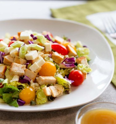 Chicken Quinoa Salad on Greens with Asian Dressing