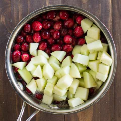 Update your Homemade Cranberry Sauce with apples for a simple and sweet twist on the classic Thanksgiving side. Tasty without getting too crazy!