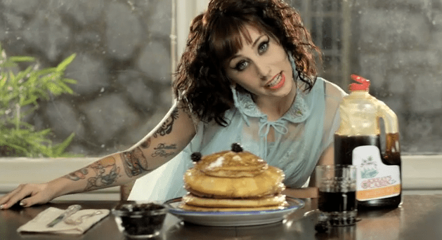 "Clearly, Kreay has a thing for food as you can see from this still taken from the video for a single called ""Breakfast"""