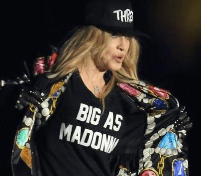 "Sporting a shirt that says ""Big As Madonna,"" per Drake's song lyrics"