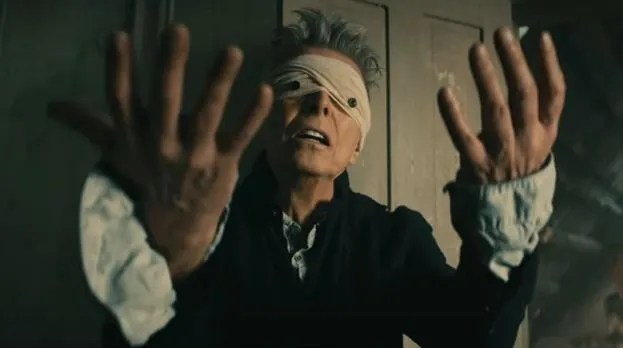 "Women With Unibrows and Scarecrow Men Brighten Up David Bowie's ""Blackstar"" Video"