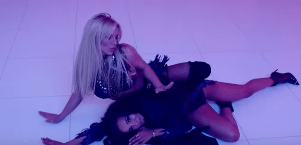 "The Ghost of Kesha's Early Career Infiltrates Britney Spears' ""Slumber Party"" Video"