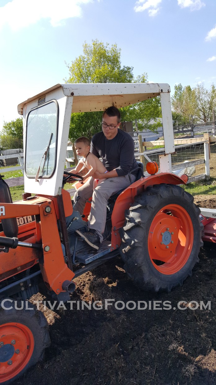 James and Littel Chef on the tractor.jpg