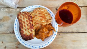 Campfire butter chicken and grilled naan bread.