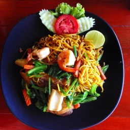 Fried yellow noodles with vegetables and seafood