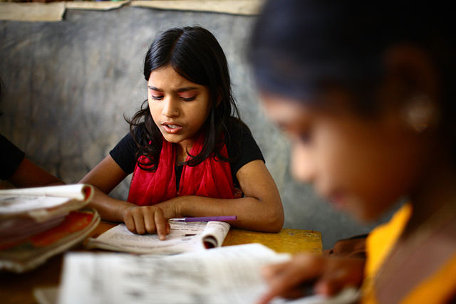 """""""10 years old Dipa and 12 years old Laboni study in class 2 at """"Unique Child learning Center"""", Mirmur-Dhaka, Bangladesh"""" by GMR Akash - UNESCO. Licensed under CC BY-SA 3.0-igo via Wikimedia Commons - http://commons.wikimedia.org/wiki/File:10_years_old_Dipa_and_12_years_old_Laboni_study_in_class_2_at_%22Unique_Child_learning_Center%22,_Mirmur-Dhaka,_Bangladesh.jpg#/media/File:10_years_old_Dipa_and_12_years_old_Laboni_study_in_class_2_at_%22Unique_Child_learning_Center%22,_Mirmur-Dhaka,_Bangladesh.jpg"""
