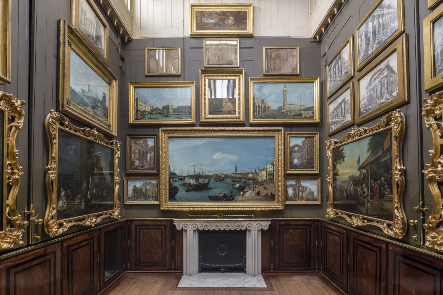 Picture room Soane Museum with Canaletto and Hogarth paintings