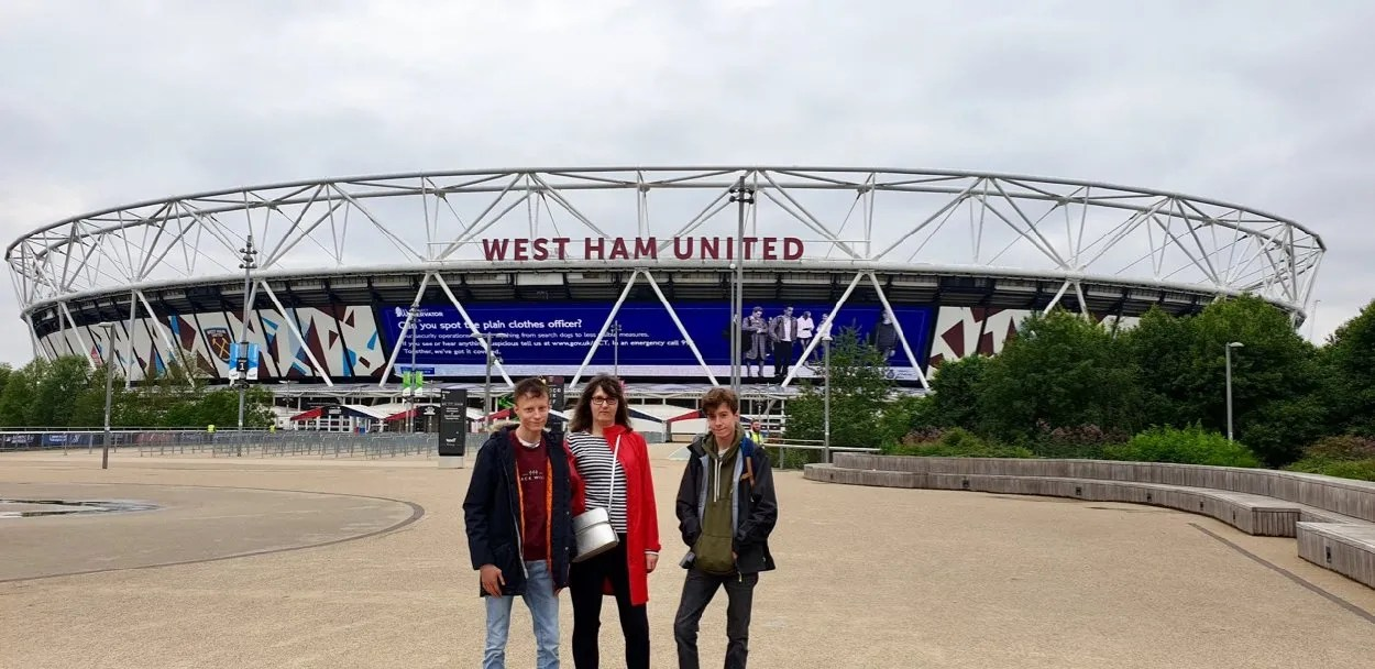 Woman and two teenagers outside London Olympic Stadium 2019