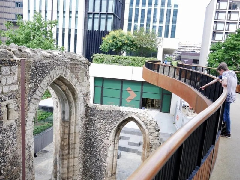 Boys point at Roman remains from St Alphage high walk London