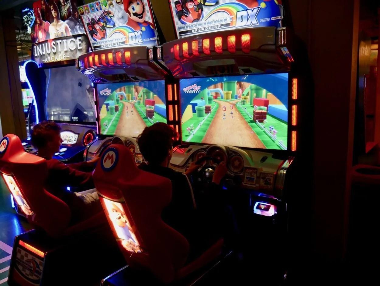 Two boys playing Mario Kart Pier 39