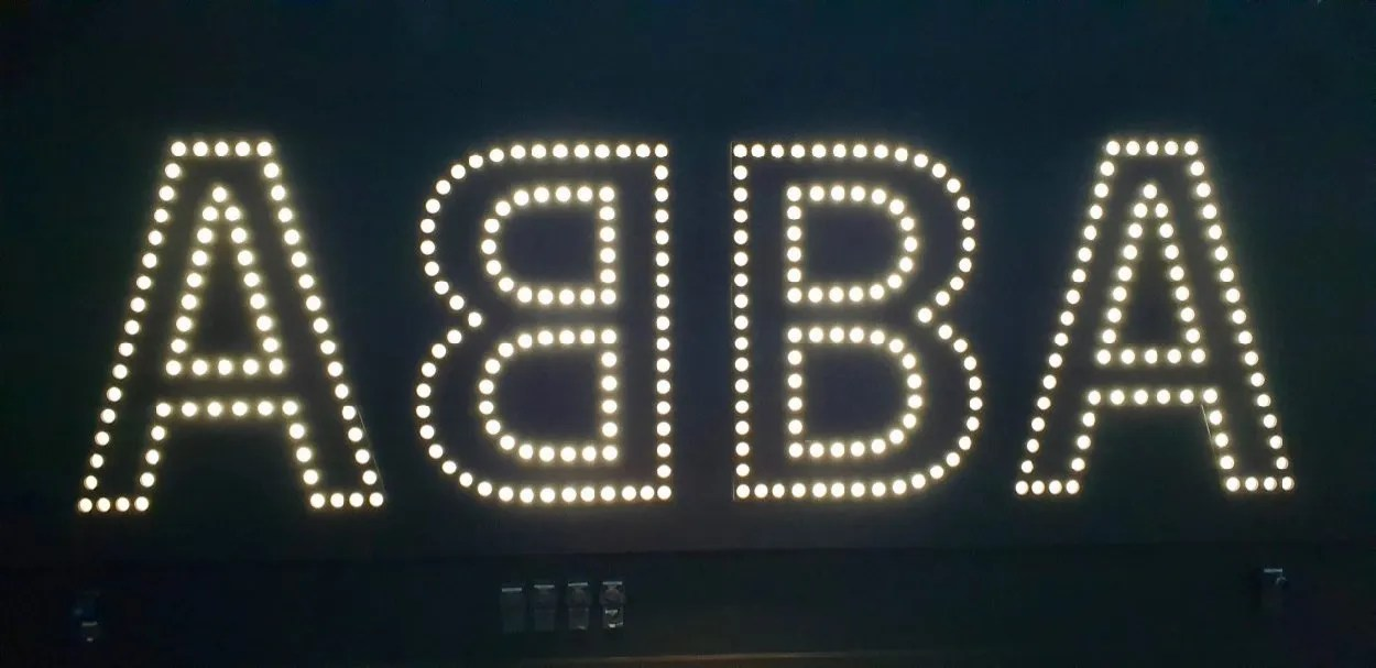 ABBA spelt out in lights.  Abba Super Troupers the Exhibition Review