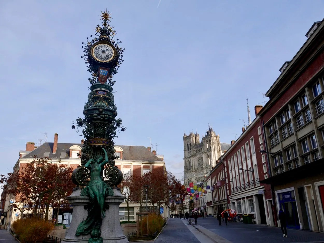 Art nouveau clock with gothic cathedral in the background