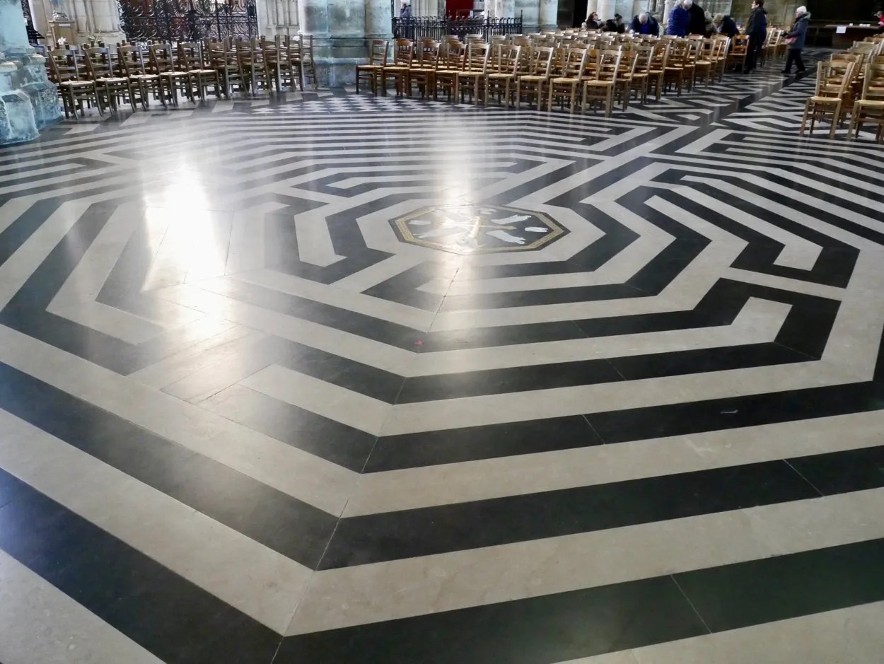 Black and white labyrinth on floor of Amiens Cathedral France