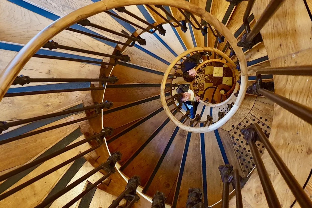 Wooden spiral staircase with two boys looking up Jules Verne House Amiens France