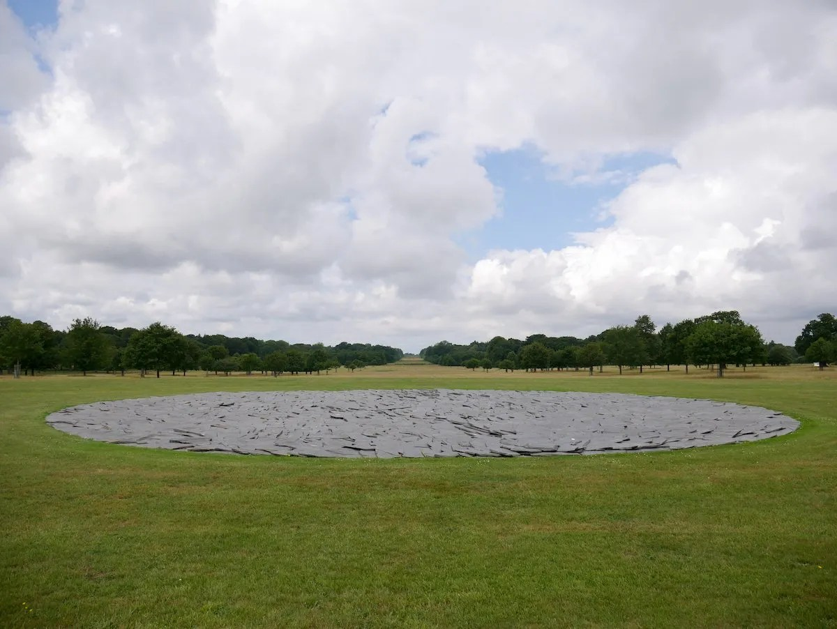 Full Moon Circle by Richard Long circle of slate set in formal landscaped park of Houghton Hall