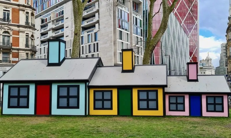Sculpture of three cartoon houses, Small, Medium and Large by Richard Woods