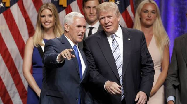 Republican U.S.presidential candidate Donald Trump (R) stands with Indiana Governor Mike Pence (L), as Trump family members look on after Pence was introduced as Trump's vice presidential running mate in New York City, U.S., July 16, 2016. REUTERS/Brendan McDermid