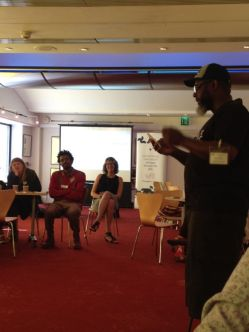 Mtima Solwazi, a T&T #WCC Ambassador performs a poem by an Ethiopian colleague at an international collaboration workshop.