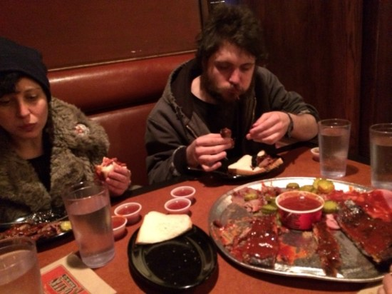 PPL (Esther Neff and Brian McCorkle) eating post-performance BBQ in Kansas City. Photo by Edward Sharp.