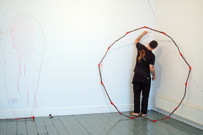 """Slow Burn,"" 5 hour drawing and gong playing action at TRACE gallery, Wales 2008"