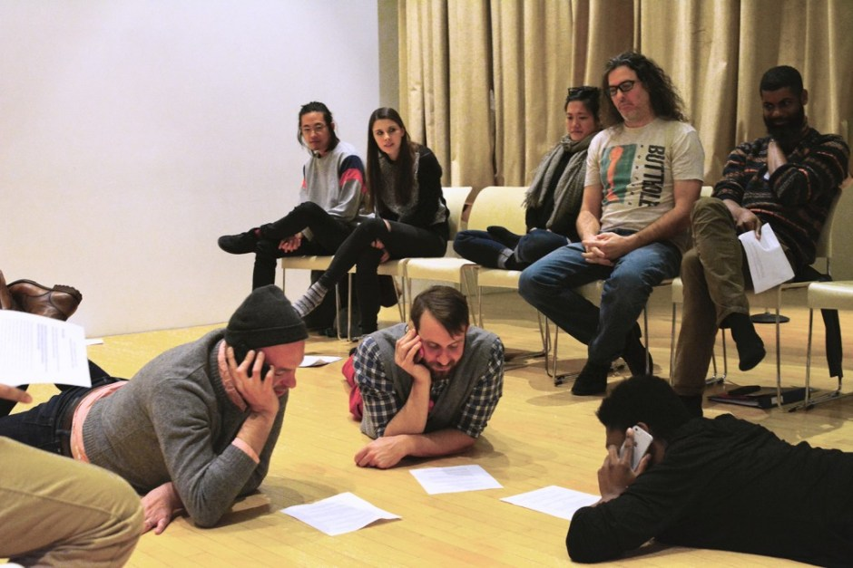 "X-ID REP participants and audience member rehearse MJ Kaufman's text ""MENINISTS""  during Director Niegel Smith's study week as part of X-ID REP at New Museum, New York, 2015."